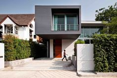 Image 1 of 37 from gallery of demoH Home / Lynk Architect. Photograph by Ketsiree Wongwan