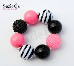This listing is for one Pink, black and zebra print bubblegum Bracelet. This is not a kit, it is made and ready to wear. This bracelet has 22mm chunky beads and elastic to fit many sizes ages 2-7 on average.   This is ready to ship!  **Despite all my efforts to accurately represent each products color, actual colors may vary due to differences in computer monitor/mobile devices. DISCLAIMER: Beads can pose choking hazards. Chunky necklaces and bracelets are made with small parts. Loose beads…