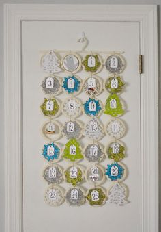 Ornament Advent Calendar using Ikea $7.99 scarf hanger ... oh Young House Love how I <3 you!