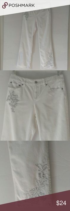 "White Ann Taylor Loft embroidered summer jeans These wonderful Ann Taylor Loft jeans are great for any spring or summer outfit.  They have beautiful metallic silver and white embroidery that can be worn casual or dressed up with the right heels.  The only flaw I could find on these are on the waistband from the imprint of the pant hanger.  These usually come out.  Measured laying flat: waste 15"", inseam  31"" rise 9"" 98% cotton 2% Lycra  They do have a bit of stretch. Ann Taylor Pants Boot…"