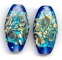 We love this bead!  Monet Waterlily Swirl Flat Ovals, 6