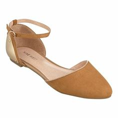 D'orsay casual flat with metal plate detailing on back and adjustable ankle strap.