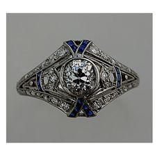 I just fell in love! Vintage art deco engagement ring with sapphire and antique diamonds. Not my size, but that's easily fixable. (Hey, a girl can dream...)