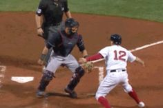 Brock Holt tried in vain to avoid an out by playing tag at home plate