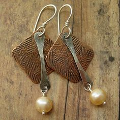 Diamond Shaped Copper Textured Sterling Silver Paddle With Pearl Earrings. $26.00, via Etsy.