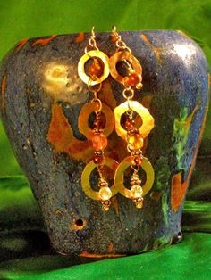 Hammered copper washers and gems. http://www.artfire.com/ext/shop/product_view/PigeonCreekSoaps/5824780/triple_dangle_copper_washer_earrings_with_gemstones/handmade/jewelry/earrings/metalsmithed