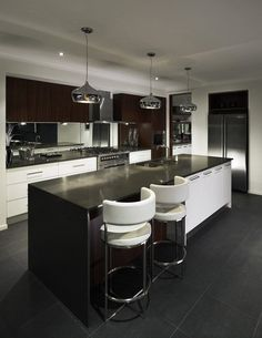 This is the most modern kitchen I have ever seen. I love the black stone countertop especially. Nothing works better than stone for a kitchen counter.