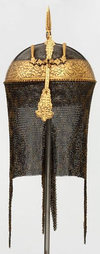 Indian (Sriringapatna) khula khud, 18th century, watered steel, chiselled wiith gold kaftkari decoration that originally had gold overlaid embellishment, now mostly missing. Transferred from the India Museum in 1879. It was said in the very brief records that came with the helmet to have been taken at the Siege of Seringapatam in 1799, when the British forces defeated Tipu Sultan, ruler of Mysore in South India. V&A Museum, England.
