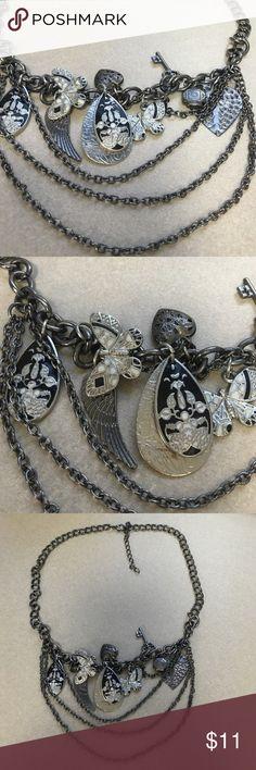 Dark Metallic Chain Charm Necklace Dark silver/metallic charm necklace. Never been worn. Maurices Jewelry Necklaces