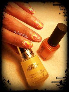 Pretty orange and yellow polish with white stripes.