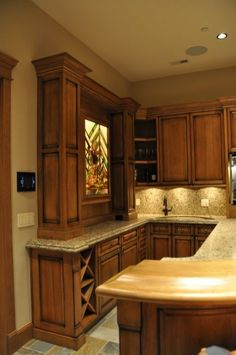Basement bar idea, love the aged accents on the cabinets