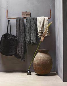 Metal pipe coat rack hanging in entryway or bedroom