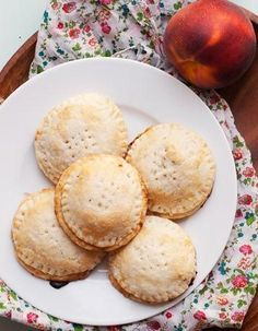 When peaches are in season, these easy hand pies are a brilliant way to use them. The assembled pies can be frozen ahead of time, too—when you're ready to bake them, simply pull them out of the freezer, brush with the egg wash, sprinkle with sugar, and toss in the oven. No defrosting needed!