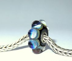 Luccicare Lampwork Bead - Wheel -  Lined with Sterling Silver by Luccicare on Etsy