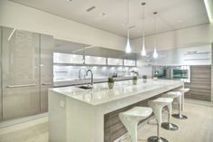 Like the 'look' w/ cabinets being my hall closets, & doors being NANAWALL. Original: poggenpohl. Very bright kitchen