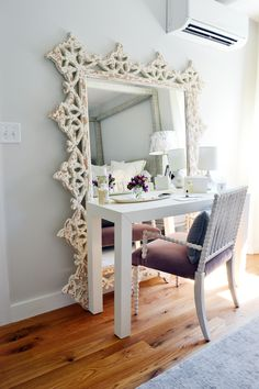 A large mirror sitting on the floor is an easy way to visually expand a small room. Love the detail of this shabby chic style mirror.