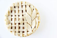 This beautiful apple pie on V & Co. has leaf cutouts on top of a lattice.