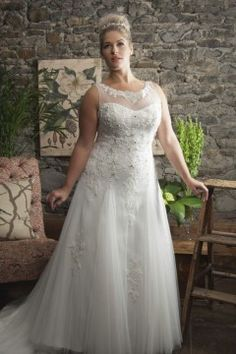 This sleeveless bridal gown has a bit of bling to the bodice. Larger brides can get custom #plussizeweddingdresses made to order however they need with our US based design firm.  We can customize a dress or make very similar #replicas of couture gowns that are not as pricey as the original.  Email us from our site for details.