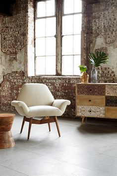 LOFTY LIVING, Spring/Summer 2015. Featuring the Carnaby armchair, the Sahara drawers and the Blaise side table. #swooneditions #furniture #interior #interiorinspiration #loftyliving #industrialroom #livingroom #brickwalls #armchair #screenprintedfurniture