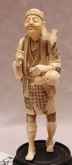 19th Century Ivory Carving of a man with gourd bottle and bird on shoulder. Condition: minor losses. Ht. 8 3/4""