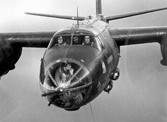 Crew in a B-26. Check the nose gunner smoking a cigarette. Amazing photo!
