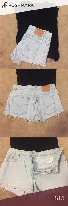 Shorts Super cute Levi shorts!! Cut off that are a light wash! They don't have the tag inside but I'm sure they are size 30! Shirt is not included just helps style it! Levi's Shorts Jean Shorts