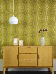 Yellow was an inspiring colour during the fifties particularly shades of ochre and acid yellow - if you love vintage style make sure you invest in some geometric style wallpaper to go with your retro furniture! All items by Tesco.
