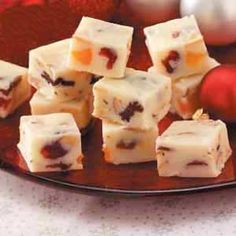 White Christmas Fudge - smooth, sweet fudge loaded with nuts and chewy fruit.  Wrap up in cute packaging and give as a diy gift.