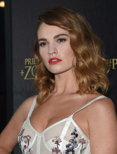 Lily James put up a stylish and sexy appearance in a cleavage barring semi sheer full length gown with floral print, while walking the red carpet at the premiere of her movie Pride and Prejudice and Zombies at the Harmony Gold Theatre in Los Angeles. At the event, which was held on January 21, 2016, she was joined by her co-stars Matt Smith and Lena Headey....