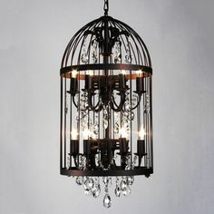 @Overstock.com - Bird Cage 12-light Chandelier  - This flamboyant bird cage chandelier has a distinctly gothic appeal. Illuminated by twelve lights, this intricate design is the perfect way to upgrade your home decor.  http://www.overstock.com/Home-Garden/Bird-Cage-12-light-Chandelier/8175682/product.html?CID=214117 $526.99