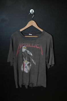 Metallica Pushead Shit Hits The Sheds Summer Tour 1994 vintage Tshirt. Size XLarge. Front and back prints. Measurements: Pit to pit: 22 Back of collar to bottom hem: 26 This shirt is in destroyed vintage condition, amazingly trashed, lots of holes as pictured. There is some fading throughout w