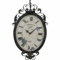 "Bring antiqued appeal to your parlor or living room decor with this vintage-inspired wall clock, showcasing a scrolling frame and Roman numeral dial.    Product: Wall clockConstruction Material: Metal and woodColor: Black and white Accommodates: Batteries - not included Dimensions: 27.5"" H x 16.5"" W x 1.25"" D"