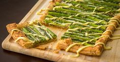 Love the combination of salty cheese, earthy asparagus, and sweet and tart balsamic vinaigrette here, not to mention how cute it looks all sliced up! It makes a lovely addition to any springtime spread, particularly brunch (our favorite meal). When we want to wow our friends and family, we whip up this savory tart – they're always amazed at how elegant it is, and we're always amazed at how easy and delicious it is! Easy And Elegant Asparagus Tart