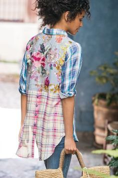 With surprises front to back, this drapey shirt is sure to delight. Rich, yarn-dyed plaid three-quarter length sleeves and body give way to an embroidered floral design on lightweight georgette. With collar, patch pocket and high-low hem.
