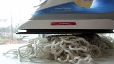 De-kinking frogged yarn ..... if you are using acrylic, hold your yarn an inch or more above (2 - 3cm) the yarn ...... even with wool or natural fibres, I never put my iron directly onto the fibre but hold the same distance away....