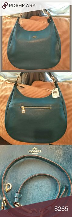 """Brand New!!! NWT Coach Pebbled HRLY Hobo Large This is a brand new,  this season bag!!!! It's that gorgeous fall color of a vibrant teal.  The photos do a good job of capturing the color! Can't fit it in my closet!  14""""W x 11""""H x 4.5"""" Depth.   Comes with gold tone accents,  shorter hand or shoulder strap PLUS a detachable, adjustable, longer,   shoulder strap! No dust bag,  but have original shop bag and receipt.   Largest size in this style!  Super stylish! I wish I could keep it!!!! Coach…"""