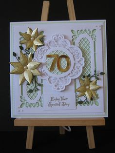 70th Birthday Card using,  Creative Expressions bright white & honeydew foundations card-stock. Sue Wilson's, lattice window striplet, MAGGIE frames and tags & Tattered Lace branch die sets. Stamps by Chloe - Four petal flower .