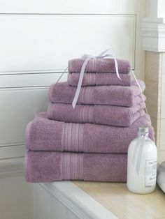 Lavender towels create a sense of calm in this bathroom.    Find out what type of home decor style you have by taking our Stylescope quiz. Click here!