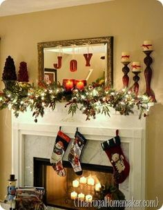 Christmas mantel idea - would hang mirror higher and stockings as well. Like concept of mirror and letters or may use wreath