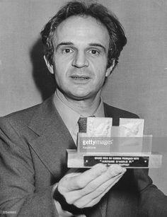 French film director Francois Truffaut holding his Grand Prix du Cinema award for 'La Nuit Americaine', Paris, circa 1960.