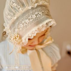 This precious bonnet is a modified version of a French bonnet. It is created using a variety of laces from Spanish to English to French Valenciennes laces. The puff is made entirely of lace as is the headband. The bonnet is finished with lace edging. The streamers are made using double-sided satin ribbon. This bonnet may be made to your specifications and measurements. Please contact me to discuss design options and for current turn around times.