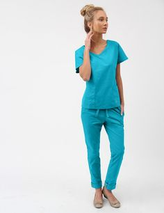 The Dolman Top in Teal is a contemporary addition to women's medical scrub outfits. Shop Jaanuu for scrubs, lab coats and other medical apparel. Womens Fashion For Work, Work Fashion, Lab Coats For Men, Jaanuu Scrubs, Scrubs Outfit, Scrubs Uniform, Womens Scrubs, Medical Scrubs, Work Clothes