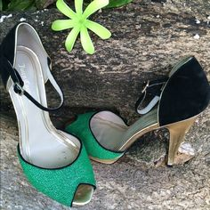 "Juicy Couture Peep Toe Peep toe, buckled ankle strap, suede piping. Green embossed and black suede color block upper. Gold tome metallic heel and platform. Leather lining and leather sole. Has some scuffs and marks otherwise in good condition  5"" heel. Juicy Couture Shoes"