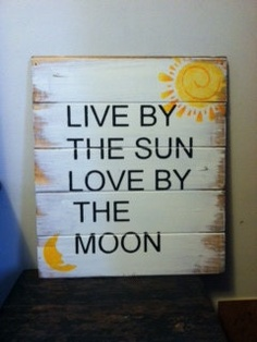 Sign: Live by the sun Love by the moon. $26.00, via Etsy.
