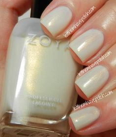 Zoya Gaia- color is BEAUTIFUL, stunning really... A Pearly, shimmering White with the most perfect Golden shimmer running though it. Bridal perfection...