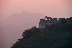 When I was at the Great Wall that evening, I kept hiking along the old wall as the sun set. I also had a zoom lens (28-300mm) with me, so I was able to get in tight on far away structures and shapes. Not too long after I took this shot, I walked along several lengths of the wall to get to these ruins. I stood there for a long time listening to music and taking photos. - Beijing, China - Photo from #treyratcliff Trey Ratcliff at http://www.StuckInCustoms.com