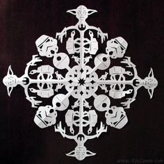 "Artist Creates Highly Detailed Pop Culture Themed Paper Cut Snowflakes. ""For years I've been an artist of many different mediums, always excited to try an art form that's new to me. One year, during winter, I was working in a central glass office inside of a larger office building. The person who had been in the position before me had created hand-cut snowflakes to hang in the glass windows around our office..."""