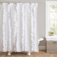 @Overstock.com - Lush Decor Belle White Ruffled Shower Curtain - Add a feminine touch to your bathroom with this elegant ruffled shower curtain from Lush Decor. It is ideal for use in teens' bathrooms and dorm bathrooms, and it should be paired with a plastic shower curtain to keep the curtain looking great.  http://www.overstock.com/Bedding-Bath/Lush-Decor-Belle-White-Ruffled-Shower-Curtain/8237637/product.html?CID=214117 $36.89