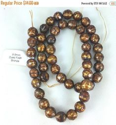Featured Product of the Day! 8-9mm Dyed Fresh Water Pearl Bronze - 16 Strand - 48 beads #PattyTiry #PearlGrade #GlassBead #beads #16InchStrand #RedCranberry #DarkBrownCopper #BeadPrestige #CulturedFreshwater #78mm7mm7Mm #8mm8Mm #Bronze9mm #8mm9mm8Mm9Mm http://buff.ly/2kNGSEx Like us on Facebook - http://buff.ly/2kNzfxRhuh . . . . #beadprestige #etsy