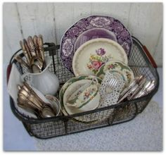 Old dishes in wire basket just for decoration